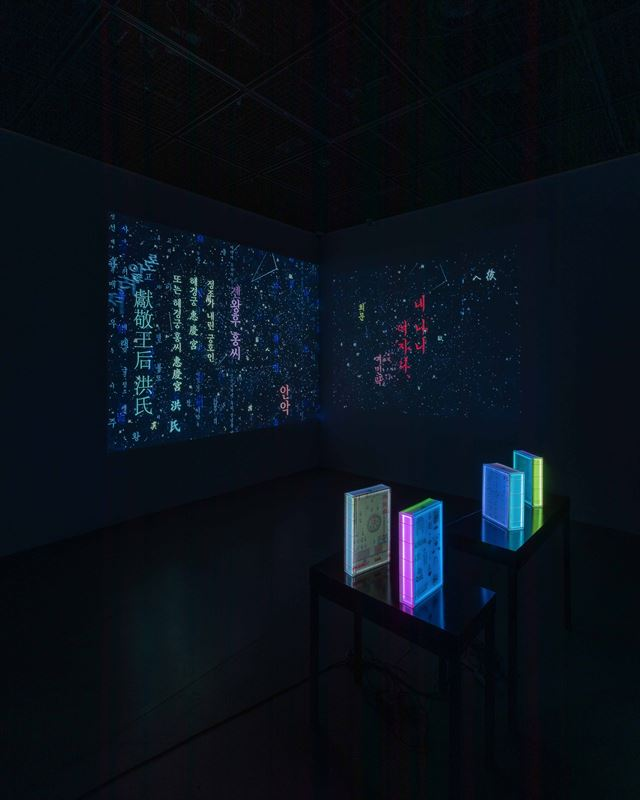 'Black Project 2020' (1998-2020) by Chang Hae-hong, left, and 'Seeding of Light - 999' (1998) by Yun Suk-nam / Courtesy of Suwon Museum of Art