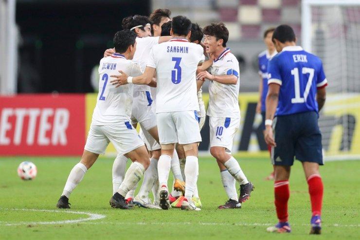 Suwon Samsung players celebrate their third goal during the AFC Champions League round of 16 football match against Japan's Yokohama F. Marinos on Dec. 7, 2020, at the Khalifa International Stadium in the Qatari capital of Doha. AFP