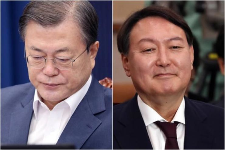 South Korean President Moon Jae-in, left, and Prosecutor General Yoon Seok-youl. Korea Times file