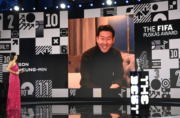 Host Reshmin Chowdhury speaks to Son Heung-min after he won the Puskas award at the Best FIFA Football Awards Ceremony in Zurich, Switzerland, Thursday, Dec. 17, 2020. AP