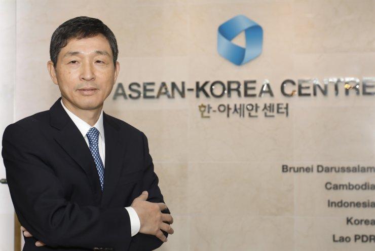 ASEAN-Korea Centre Secretary General Lee Hyuk poses at the entrance of the center in downtown Seoul. / Courtesy of ASEAN-Korea Centre