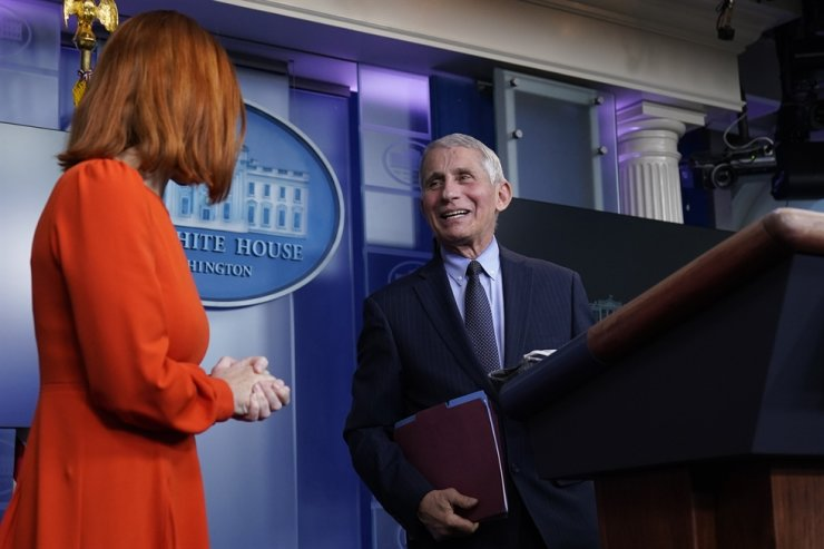 White House press secretary Jen Psaki speaks with Dr. Anthony Fauci, director of the National Institute of Allergy and Infectious Diseases, during a press briefing in the James Brady Press Briefing Room at the White House, Thursday, Jan. 21, 2021, in Washington. AP