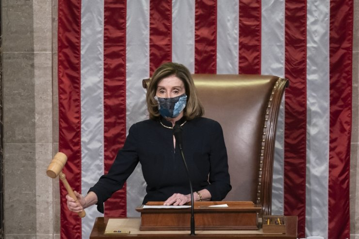 Speaker of the House Nancy Pelosi, D-Calif., leads the final vote of the impeachment of President Donald Trump for his role in inciting an angry mob to storm the Congress last week, at the Capitol in Washington DC, Jan. 13, 2021. AP
