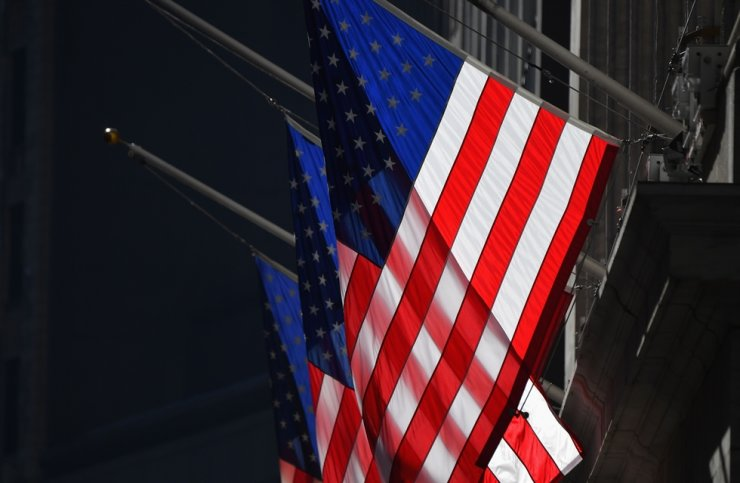 U.S. flags are seen at New York Stock Exchange at Wall Street on Jan. 12, 2021, in New York City. AFP