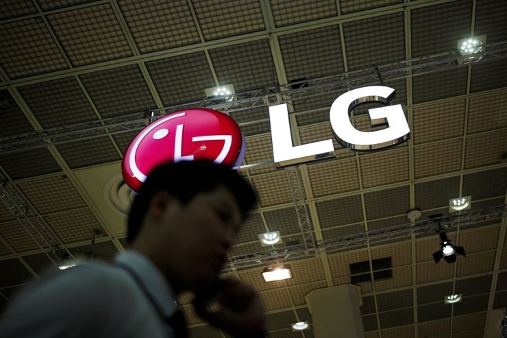 A man talking on his phone walks past the logo of LG Electronics during Korea Electronics Show 2016 in Seoul, Oct. 27, 2016. Reuters