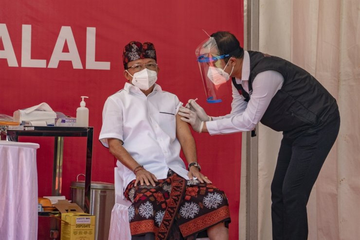 Bali Governor Wayan Koster, left, is injected with a COVID-19 vaccine at a hospital in Denpasar, Bali, Indonesia, Jan. 14, 2021. EPA