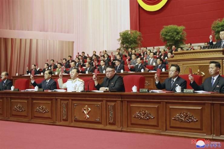In this photo provided by the North Korean government, North Korean leader Kim Jong-un, center, attends the ruling party congress in Pyongyang, North Korean, Sunday, Jan. 10, 2021. Nobody is seen wearing a mask. AP