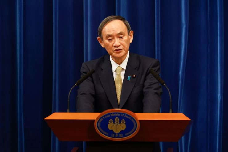 Japan's Prime Minister Yoshihide Suga speaks during a press conference at his official residence in Tokyo, Wednesday, stating that 11 of the country's 47 prefectures will be under the state of emergency. AFP-Yonhap