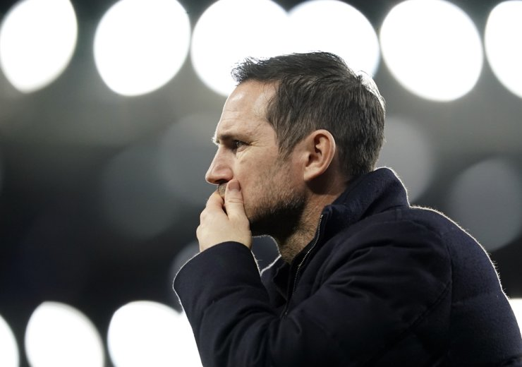 In this Dec. 12, 2020, file photo, Chelsea's head coach Frank Lampard walks during the warm up before the English Premier League soccer match between Everton and Chelsea at Goodison Park in Liverpool, England. Lampard has been fired by Chelsea halfway through his second season on Jan. 25, 2021. AP