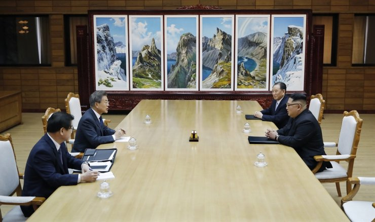 President Moon Jae-in and North Korean leader Kim Jong-un sit face to face during a meeting at Panmungak in North Korea in May 2018. Courtesy of Cheong Wa Dae