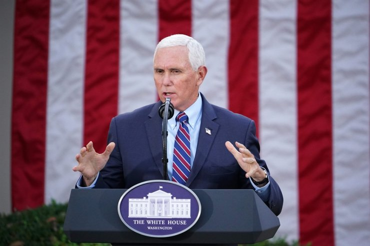 In this file photo taken on Nov. 13, 2020, U.S. Vice President Mike Pence delivers an update on 'Operation Warp Speed' in the Rose Garden of the White House in Washington, DC. Pence on Jan. 12, 2021, told House leaders he does not support invoking the 25th Amendment process to remove President Donald Trump. AFP