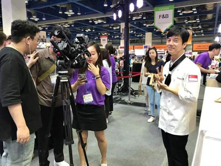 Ng Keng Leng, the founder and CEO of Dessert Merlion Cafe in Seoul, is interviewed by a Korean media outlet during the ASEAN Culinary Festival in June 2017. / Courtesy of Dessert Merlion Cafe