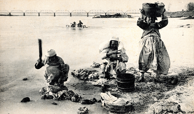 Ice fishing on the Han River. Circa early 1900s.  Robert Neff Collection