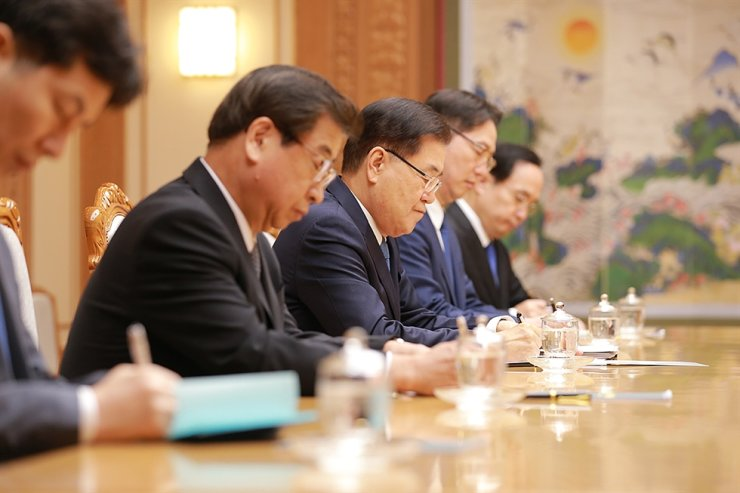 Then-national security adviser Chung Eui-yong, third from left, and then-National Intelligence Service chief Suh Hoon, second from left, hold a meeting with North Korean leader Kim Jong-un, Sept. 5, 2018, during their visit to Pyongyang as presidential envoys. A third summit between President Moon Jae-in and Kim took place about two weeks after their visit. Chung was sworn in as foreign minister, Tuesday, and Suh succeeded Chung as President Moon's national security adviser in July 2020. Courtesy of Cheong Wa Dae