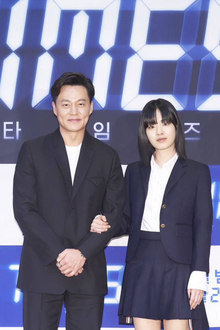 Actors Lee Seo-jin, left, and Lee Joo-young pose for photos during an online media conference for OCN's TV series 'Times,' Tuesday. Courtesy of OCN