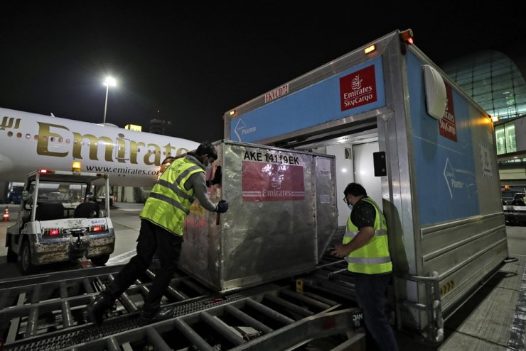 A Pfizer-BioNTech COVID-19 vaccine shipment is offloaded from an Emirates Airlines Boeing 777 that arrived from Brussels to Dubai International Airport in the United Arab Emirates, Feb. 21. AP-Yonhap