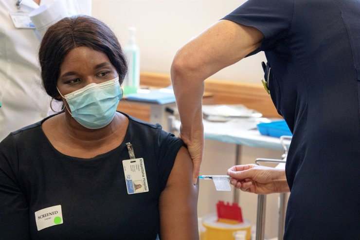 A South African health worker receives the Johnson and Johnson coronavirus disease (COVID-19) vaccination at the Khayelitsha Hospital near Cape Town, South Africa, Feb. 17, 2021. Reuters