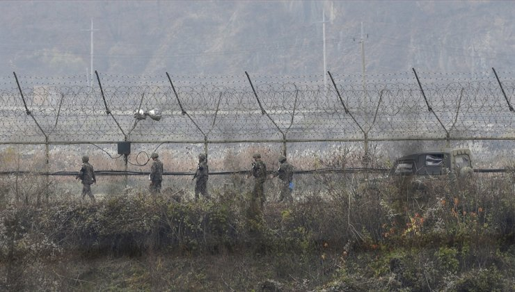 In this Nov. 16, 2018, file photo, South Korean army soldiers patrol along the barbed-wire fence in Paju, South Korea, near the border with North Korea. AP