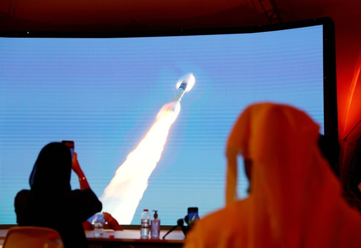 People watch a big screen displaying the launch of the Hope Probe from Tanegashima Island in Japan, at the Mohammed bin Rashid Space Centre in Dubai, United Arab Emirates July 20, 2020. REUTERS-Yonhap