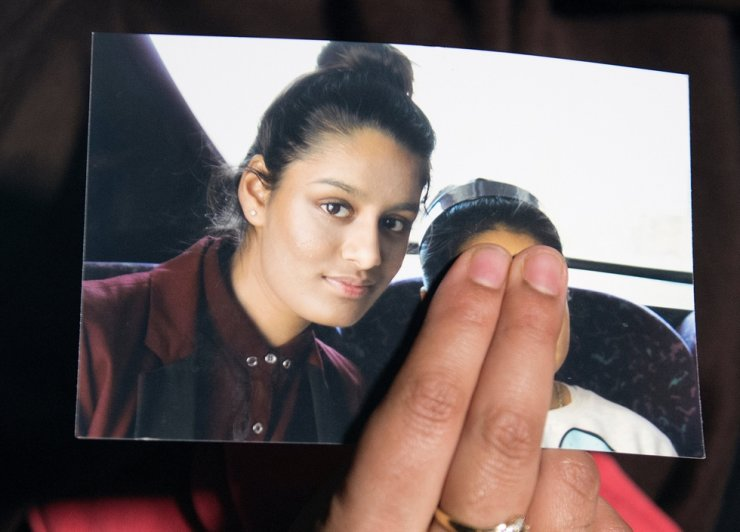 Renu Begum, sister of teenage British girl Shamima Begum, holds a photo of her sister as she makes an appeal for her to return home at Scotland Yard, in London, Feb. 22, 2015. Britain's highest court on Feb. 26, 2021, rejected the attempt. Reuters