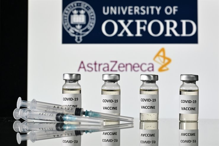 This file illustration photo taken on Nov. 17, 2020, shows vials with COVID-19 Vaccine stickers attached and syringes, with the logo of the University of Oxford and its partner British pharmaceutical company AstraZeneca. AFP