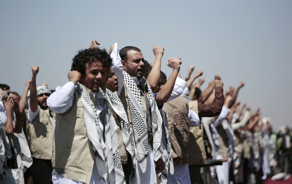 Houthis-allied tribesmen holding up weapons shout slogans during a rally against the US terrorist designation of the Houthis, in Sanaa, Yemen, Feb. 4, 2021. EPA-Yonhap