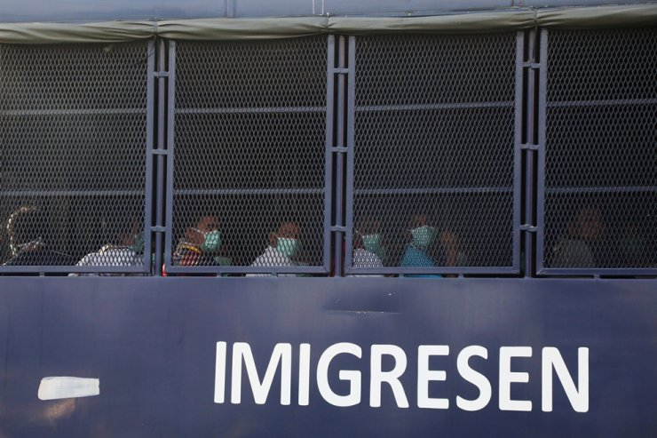 Myanmar migrants to be deported from Malaysia are seen inside an immigration truck in Lumut, Malaysia, Feb. 23. AP