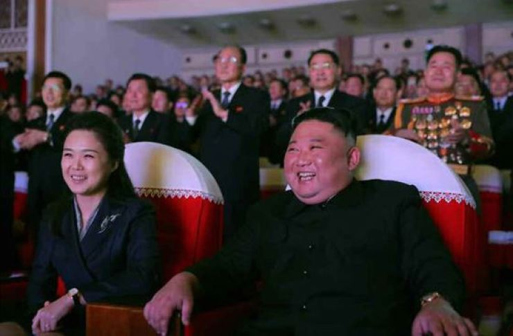 North Korean leader Kim Jong-un and his wife Ri Sol-ju attend a concert commemorating the birthday of late leader Kim Jong-il on Tuesday, state media reported Wednesday. Yonhap
