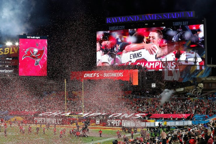 Tampa Bay Buccaneers quarterback Tom Brady and Tampa Bay Buccaneers wide receiver Mike Evans are shown hugging on the big screen after the Tampa Bay Buccaneers defeated the Kansas City Chiefs in the National Football League Super Bowl LV at Raymond James Stadium in Tampa, Fla., Feb. 7, 2021. EPA