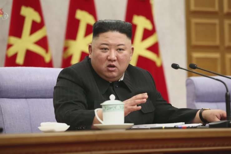 State TV footage shows North Korean leader Kim Jong-un presiding over a party meeting, Feb. 8. Yonhap