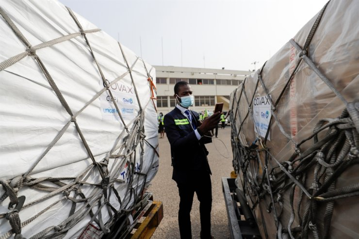 A worker checks boxes of AstraZeneca/Oxford vaccines as the country receives its first batch of coronavirus disease (COVID-19) vaccines under COVAX scheme, at the international airport of Accra, Ghana, Wednesday. Reuters