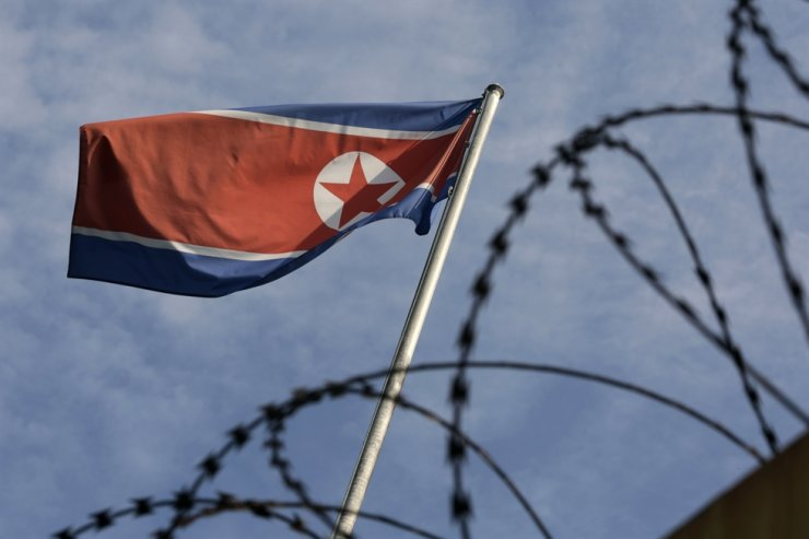 A North Korean flag flies over the North Korean Embassy in Kuala Lumpur, Malaysia, March 20, 2021. A rancorous U.S.-China rivalry that appears to have brought North Korea and China even closer is casting a pall over cooperation between the major powers in charting a course for Pyongyang's denuclearization, experts say. EPA