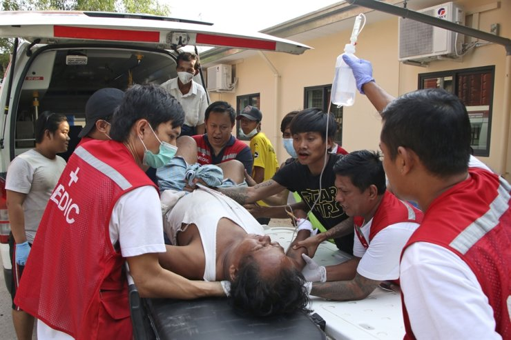 An injured anti-coup protester is brought for medical treatment to a hospital in Latha township, Yangon, Myanmar, Saturday, March 27, 2021. AP-Yonhap