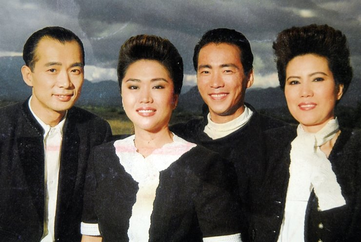Lee Yong-gyu, second from right, of mega 1980's Korean pop group, Koreana, is pictured here with fellow members. Korea Times file