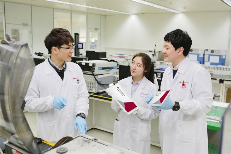 LG Energy Solution researchers pose with the company's battery cells at its R&D center in Daejeon, in this photo provided by the company, Friday. Courtesy of LG Energy Solution
