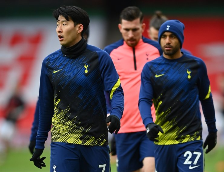 Tottenham's Son Heung-min, left, and teammates warm up for the English Premier League football match between Arsenal FC and Tottenham Hotspur in London, March 14, 2021. EPA