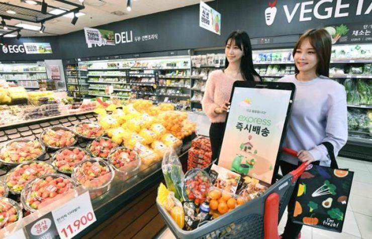 Customers shop at a Homeplus grocery store in Seoul, March 5. Courtesy of Homeplus