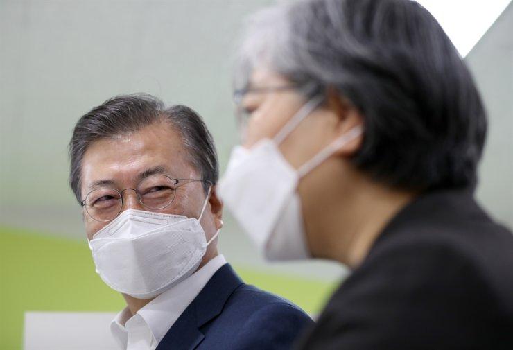 President Moon Jae-in, left / Yonhap