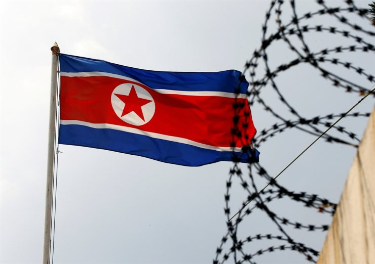 A North Korea flag flutters next to concertina wire at the North Korean embassy in Kuala Lumpur, Malaysia, March 9, 2017. North Korea's recent launch of short-range missiles is not in violation of UN Security Council resolutions, senior U.S. officials said Tuesday, calling them part of 'normal testing.' Reuters