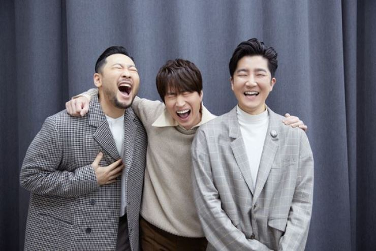 Epik High's rapper Tablo, center, with his bandmates in this photo, tweeted earlier this week regarding a licensing agreement dispute between Spotify and Kakao M, 'Why is it always the artists and the fans that suffer when businesses place greed over art?' Korea Times file