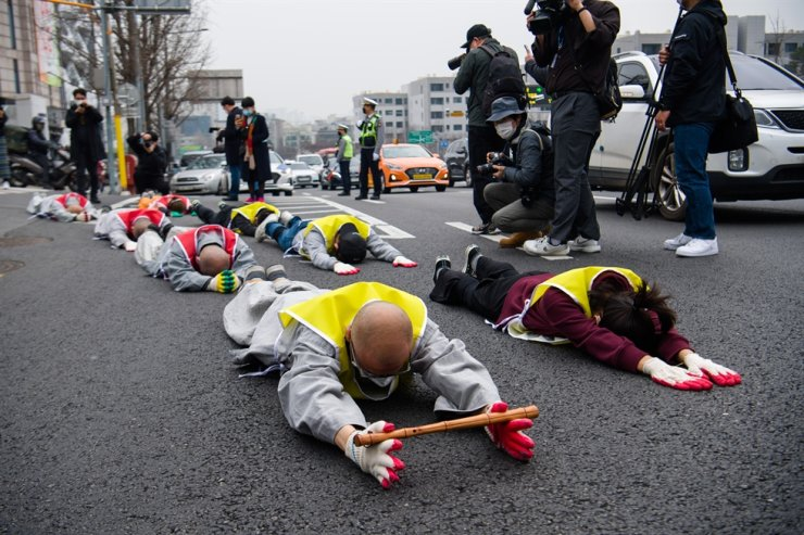 Monks and students from Myanmar hold a street protest against the military who took control of Myanmar's government by force, in Seoul, Friday. Korea Times photo by Han Jin-tak