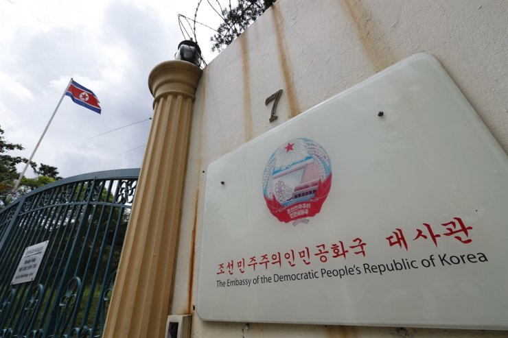In this March 29, 2017, file photo, a North Korea flag flies by the entrance to the North Korean Embassy in Kuala Lumpur, Malaysia. North Korea on Friday, March 19, 2021 said it was cutting diplomatic ties with Malaysia to protest a recent court ruling that allows a North Korean citizen to be extradited to the United States to face money laundering charges. AP-Yonhap