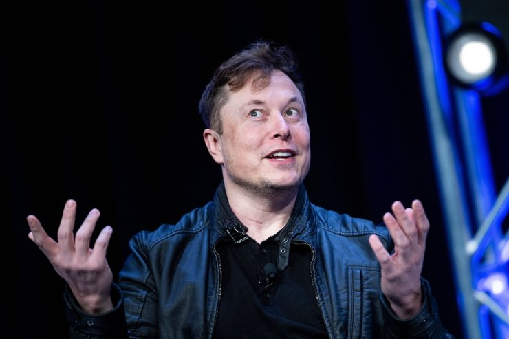 In this file photo Elon Musk, founder of SpaceX, speaks during the Satellite 2020 at the Washington Convention Center on March 9, 2020, in Washington, DC. Tesla began officially accepting bitcoin as currency to purchase electric autos, Chief Executive Musk said on March 24, 2021. AFP