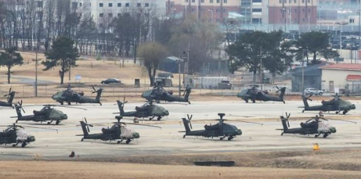 AH-64 Apache attacker helicopters parked at Camp Humphreys in Pyeongtaek, Gyeonggi Province, March 7. Yonhap