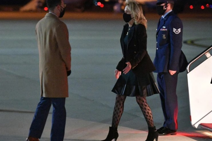 Jill Biden, center, at Andrews Air Force Base in Maryland, the United States, on April 1 in this photo, has sparked an online debate over her patterned tights. AFP
