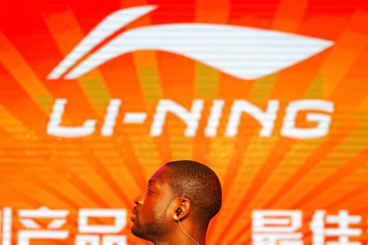 Former NBA Miami Heats Dwyane Wade stands in front of a company logo of Li Ning during a promotional event for Li Nings Way of Wade sneakers in Beijing in July 2013. Wade signed a multi-million dollar contract with Li Ning in 2012 but the sneakers that bear his name are in short supply. Reuters