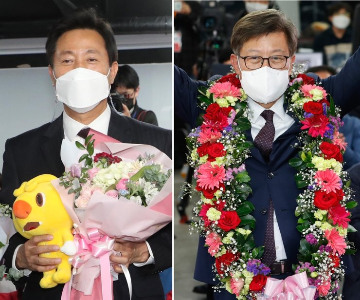 Oh Se-hoon, left, and Park Heong-joon, the candidates of the main opposition People Power Party for Seoul and Busan mayor posts, react at the party headquarters in Seoul and Park's election camp in Busan, respectively, early Thursday morning, after their victory in the by-elections has almost confirmed. Yonhap