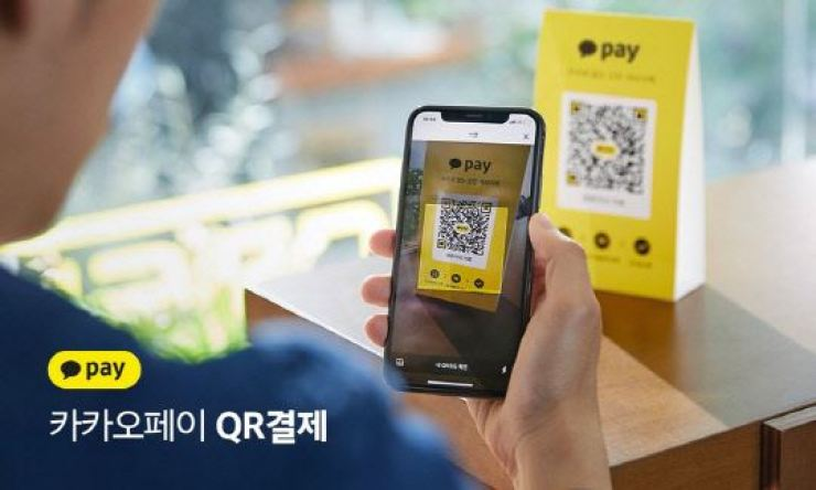A KakaoPay user makes a payment with his smartphone using a QR code in this file photo. Courtesy of KakaoPay