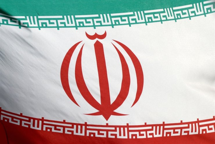 The Iranian flag waves in front of the International Atomic Energy Agency headquarters in Vienna, Austria, March 1. Reuters