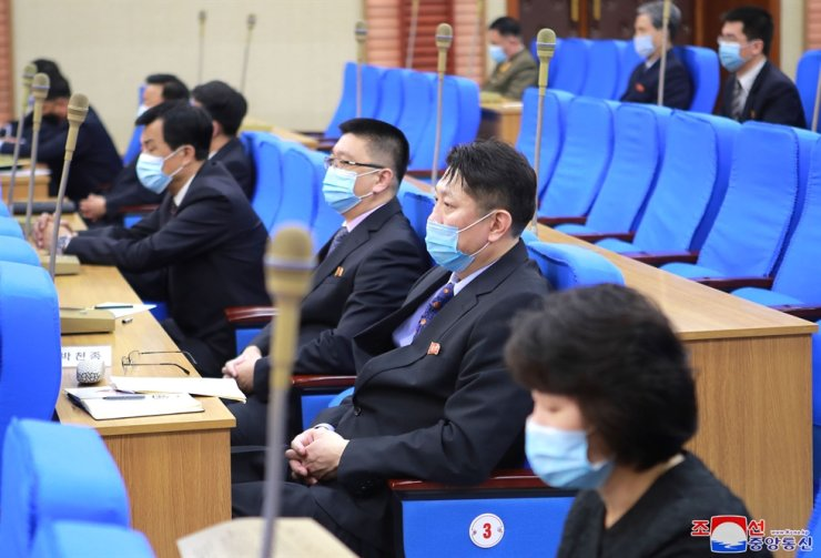 In this photo released by Korea Central News Agency on March 26, North Korean officials are seen during the country's Olympic Committee meeting. Yonhap